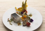 Thick sea bass steak with wild fennel stems, confit Provencal vegetables and vierge sauce