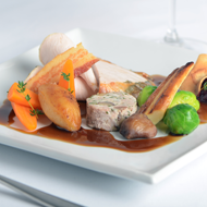 Roast turkey with chestnut stuffing, seasonal vegetables, cranberry compote and port wine jus