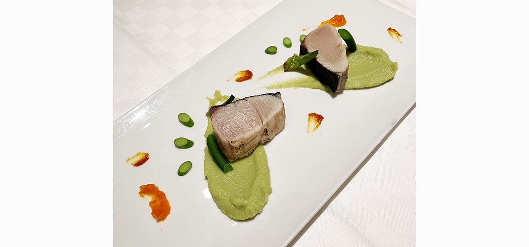 seared sawara fillet, paired with shio-uni and yama-uni, soramame puree, garlic bud garnish